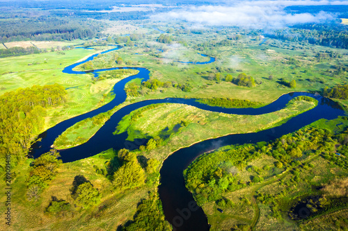 Foto auf Gartenposter Pistazie River nature. Wild river along green meadow from above. River landscape aerial view. Scenic summer nature