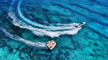Yachts At The Sea Surface. Aerial Panoramic View Of Luxury Floating Boat On Transparent Turquoise Water At Sunny Day. Top View From Drone. Seascape With Motorboat In Bay. Travel - Image