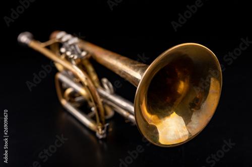 Old trumpet on a dark wooden table Fototapeta