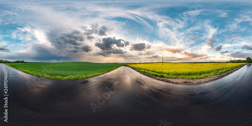 Foto auf Gartenposter Grau Verkehrs full seamless spherical hdri panorama 360 degrees angle view on wet asphalt road among canola fields in evening sunset after storm with awesome clouds in equirectangular projection, VR AR content
