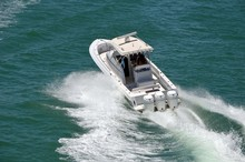 Young Couple Enjoying A High Speed Pleasure Cruise On The Florida Intra-Coastal Waterway In A Small Sport Fishing Boat