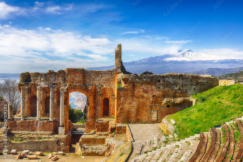 Fototapeta Ruins of ancient Greek theater in Taormina and Etna volcano in the background.