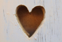 Beautiful Wooden Heart Carved Into The Board. Close-up. Background. Texture.