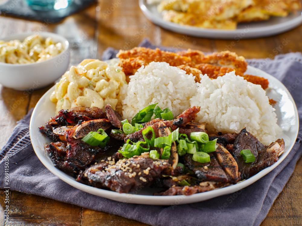 Fototapeta hawaiian bbq plate with mix of chicken katsu, korean kalbi beef short ribs, rice, and macaroni salad