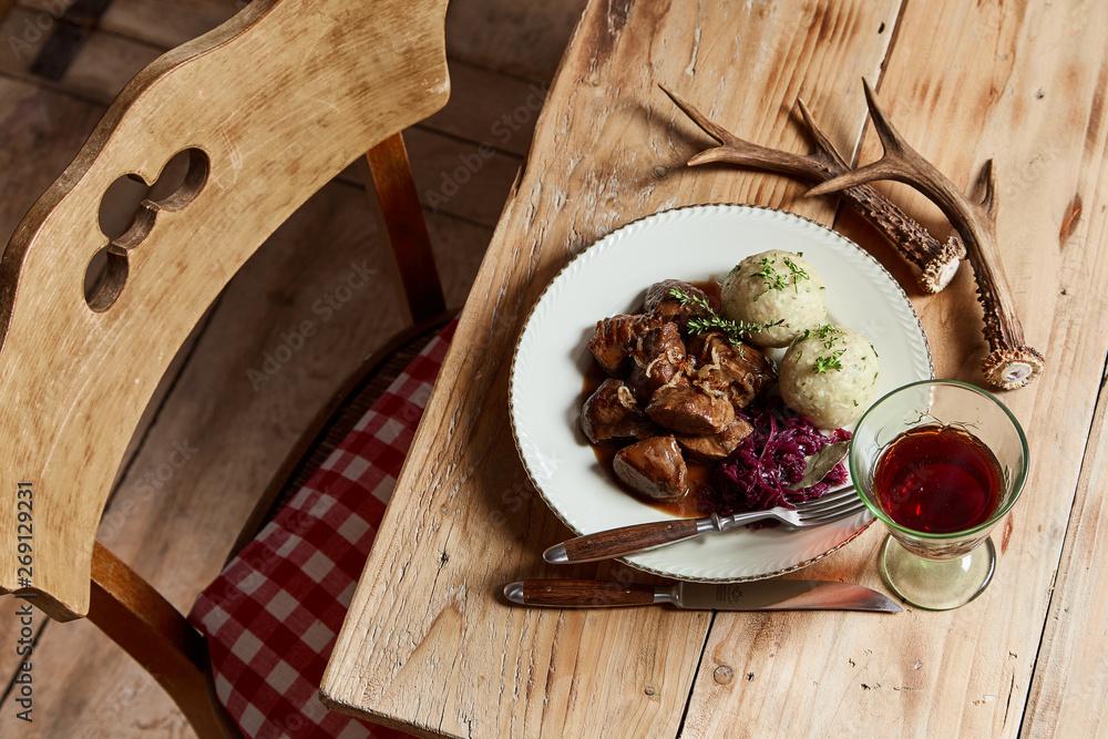 Fototapeta Plate of rich spicy wild venison goulash