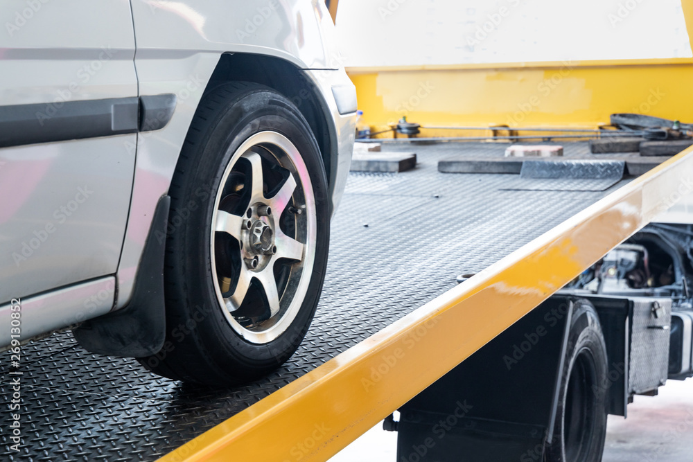 Fototapety, obrazy: Closeup on car towed onto flatbed tow truck with cable