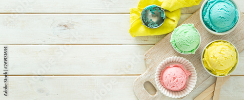 Fotografie, Obraz Pastel ice cream in white bowls, wood background, copy space