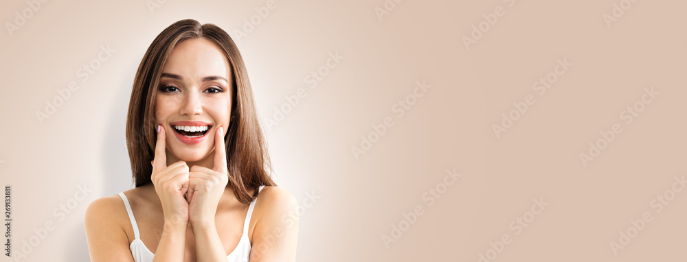 Photo  Photo of happy excited woman showing smile, over beige