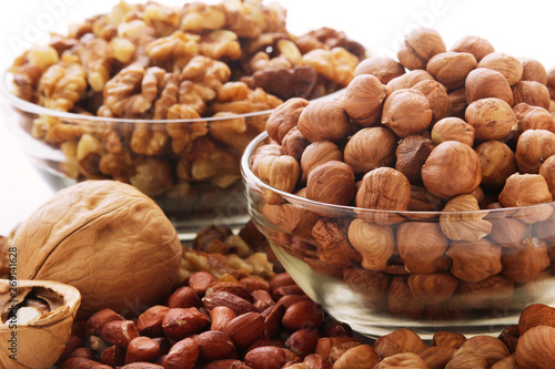 Different nuts in glass cups