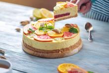 A Piece Of Raw Citrus Cake With Grapefruit, Orange, Lime And Lemon. Healthy Fresh Summer Dessert. Homemade Vegan Food