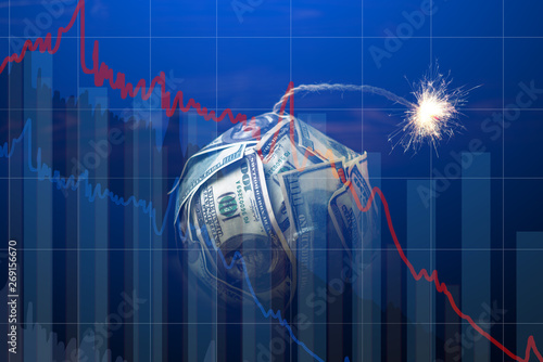 Fotografía  Bomb money with a burning wick with drop charts on blue background