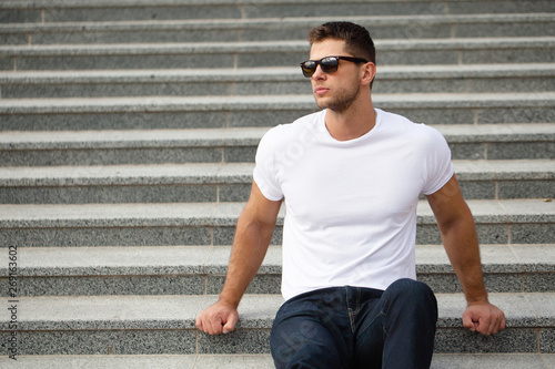 obraz PCV Hipster handsome male model with beard wearing white blank t-shirt space for your logo or design in casual urban style