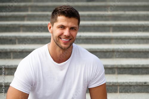 Fotografia  Perfect teeth. Man model posing