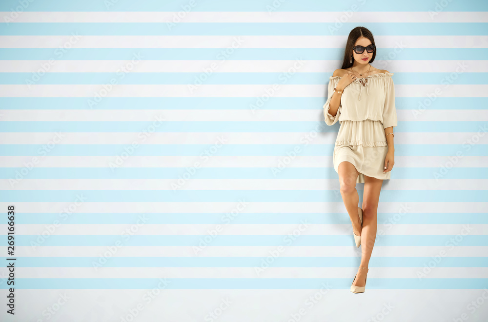 Fototapety, obrazy: Slim young woman in summer dress and wall of blue and white color. Free space for your decoration