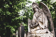 Obsolete Old Stature Of Angel With Cross On Burial On Cemetery In Lychakiv Cemetery, Lviv