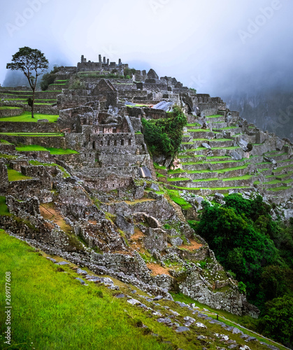 Amazing view of majestic Machupicchu temple landscape covered with fog on the ba Canvas