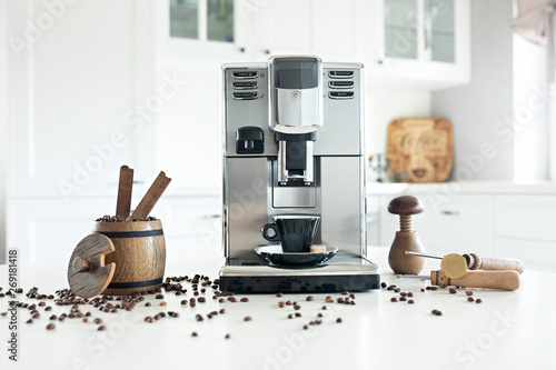 Fotografija Still life with homemade coffee machine on the kitchen table with wooden container with coffee beans