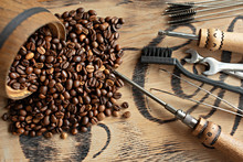 Tools For Repairing Coffee Machines Close-up. Coffee Beans, Wooden Board, Coffee Machine, Kitchen Table