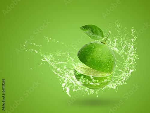 Fototapeta  Fresh green lime isolated on white background