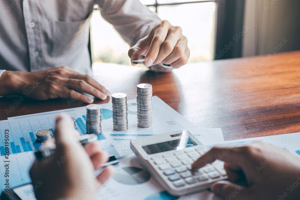 Fototapety, obrazy: Business group brainstorming on meeting to planning project finance analyzing calculate with report document, stacking coins for step up growing business to profit and saving with wealth management