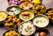 Assorted Indian/Pakistani Food In Stainless Steel Bowls Creating Pattern Or Design, Selective Focus