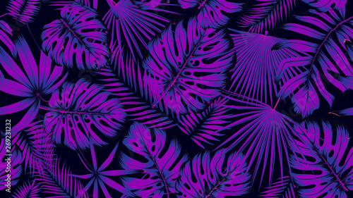 Trendy seamless tropical pattern with exotic leaves in ultraviolet light