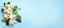 Spring Composition Of White Flowers On Blue Paper Background With Copy Space. Creative Layout. Flat Lay. Top View. Summer Minimal Concept.