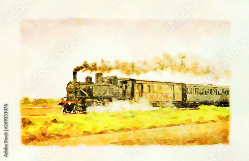 Fotografía  Ancient steam train running on tracks in the countryside on a sunny day