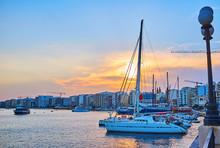Sunset Behind The Yachts' Sail...