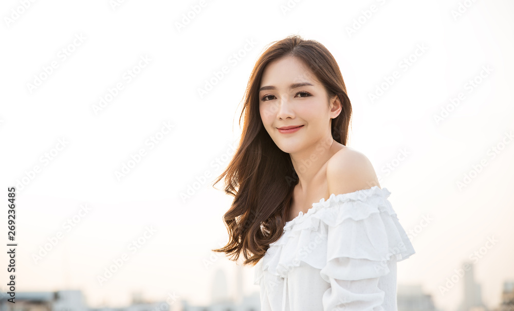 Fototapety, obrazy: Portrait of young beautiful innocence asian woman in sky roof top. Smile face asian girl wear casual cloth. Beauty treatment perfect clear skin japanese makeup  lifestyle concept
