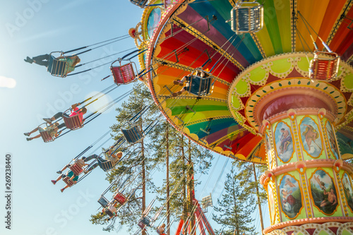 Poster Attraction parc Kouvola, Finland - 18 May 2019: Ride Swing Carousel in motion in amusement park Tykkimaki