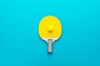 Leinwanddruck Bild - racket and ball for table tennis on turquoise blue background. flat lay image of table tennis paddle with a ball central composition. minimalist photo of yellow ping-pong equipment