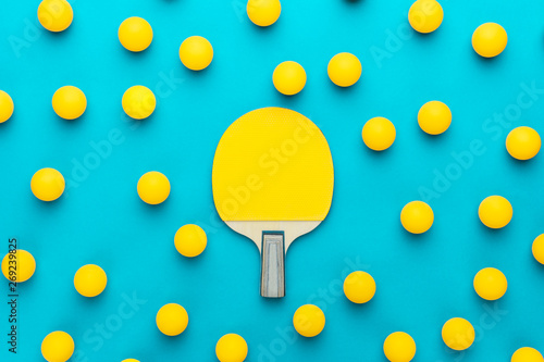 Fotografija  racket and many balls for table tennis on turquoise blue background