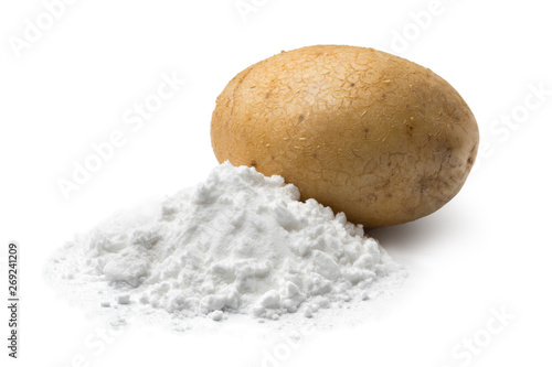 Fotografering Heap of potato starch and a fresh potato
