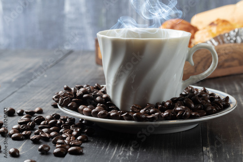 Wall Murals Cafe cup of hot coffee and roast coffee beans