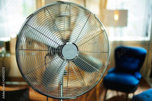 Fotografiet  Closeup on working electric floor standing fan