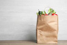 Paper Bag With Vegetables On T...
