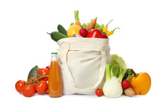 Cloth Bag With Fresh Vegetables And Bottle Of Juice On White Background