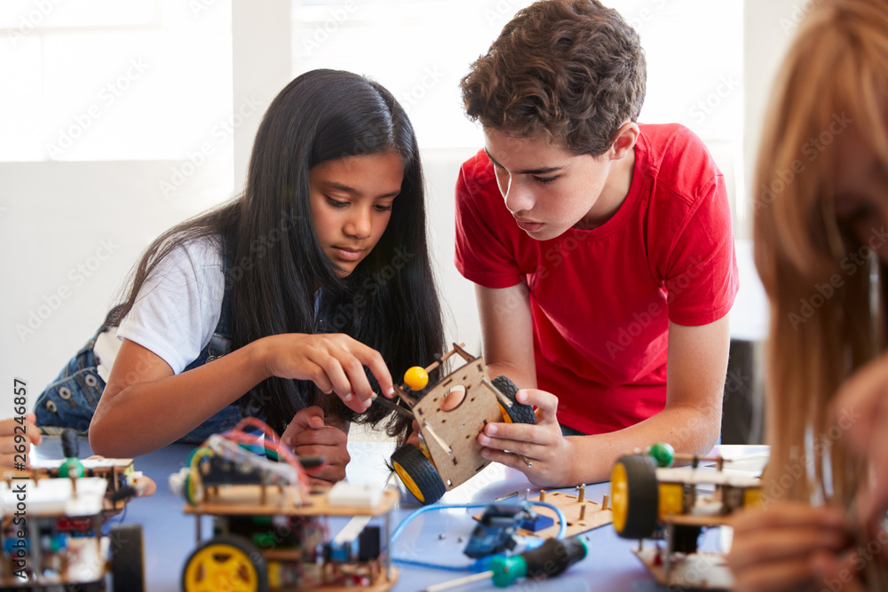 Fototapeta Two Students In After School Computer Coding Class Building And Learning To Program Robot Vehicle