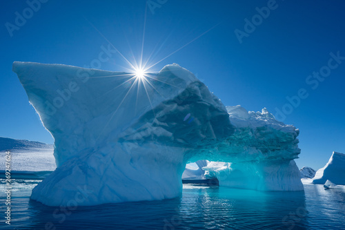 Photo Stands Antarctica Iceberg and a sun in Antarctica