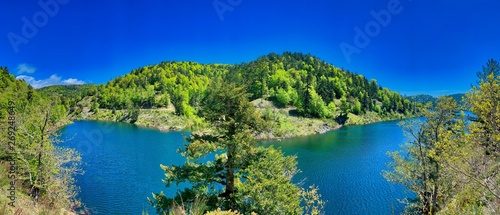 Foto op Plexiglas Donkerblauw Typical mountain lake landscape, Italy.