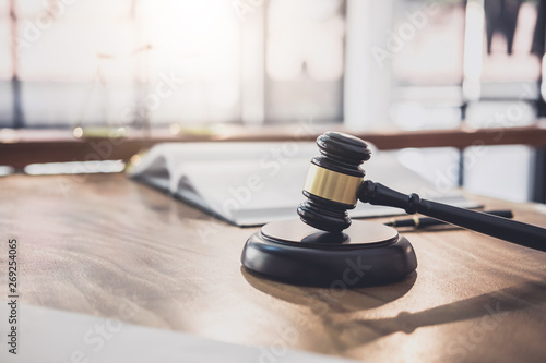 Valokuva  Scales of justice and Gavel on sounding block, object and law book to working wi