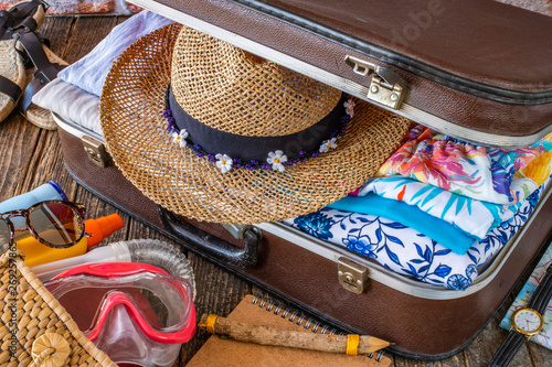 Fotografia  Suitcase preparation for a summer holiday , Retro , vintage and old luggage