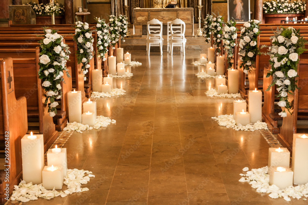 Fototapety, obrazy: Catholic temple decorated with flowers and candles for wedding