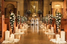 Catholic Temple Decorated With Flowers And Candles For Wedding