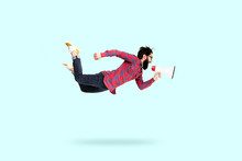 Bearded Hipster Man In Glasses, Jumping And Shouting In Megaphone, Photo Over Blue Background