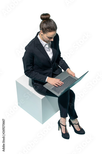 Corporate businesswoman sitting and using a laptop