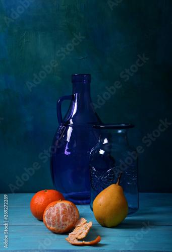Fototapeta Still life with a purple vase and fruit obraz