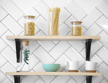 Wooden Kitchen Shelves With Cups And Glass Jars