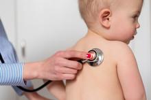 Paediatrician Using Stethoscope On Girl